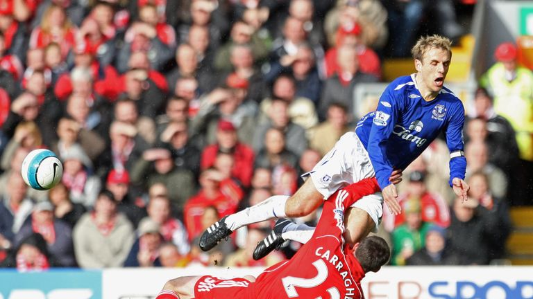 Phil Neville is tackled by Jamie Carragher during the Merseyside derby in 2008