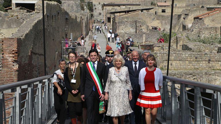 The Duchess of Cornwall, Camilla (C), with the Major of Ercolano, Ciro Buonajuto and British Ambassador in Italy, Jill Morris, right
