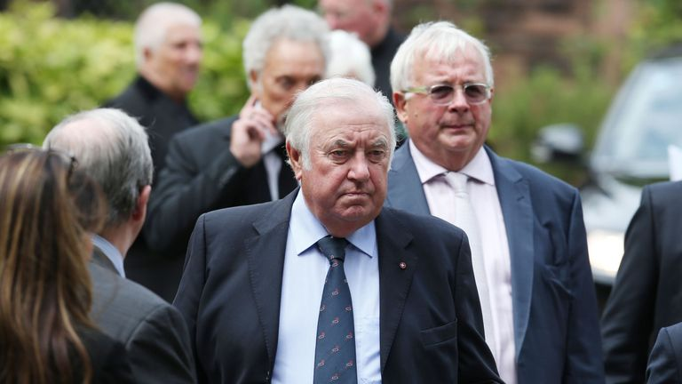 Jimmy Tarbuck (left) and Christopher Biggins leave St Mary's Church in Woolton, Liverpool following the funeral of Cilla Black