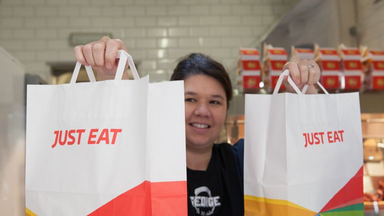 Just Eat is being accused of trying to bypass new rules banning card fees