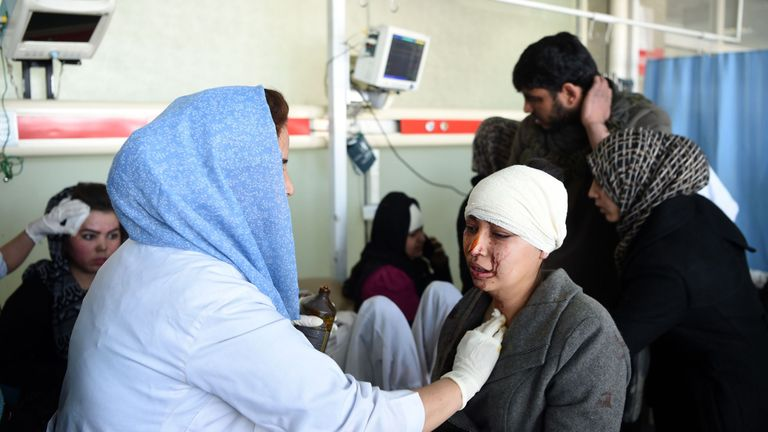 TOPSHOT - Afghan medical staff treat a wounded women, after a car bomb exploded near the old Interior Ministry building, at Jamhuriat Hospital in Kabul on January 27, 2018. An ambulance packed with explosives blew up in a crowded area of Kabul on January 27, killing at least 17 people and wounding 110 others, officials said, in an attack claimed by the Taliban. / AFP PHOTO / WAKIL KOHSAR (Photo credit should read WAKIL KOHSAR/AFP/Getty Images)