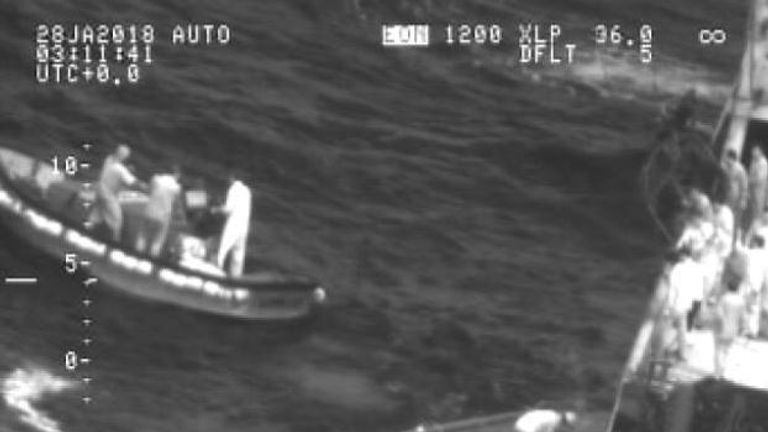 Seven people in a dinghy were found by the NZ Defence Force after a ferry capsized near Kiribati. Here they are rescued by a fishing vessel. Pic: NZ Defence Force
