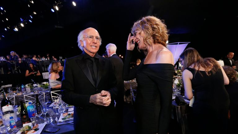 Actor Larry David speaks with actress Christine Lahti