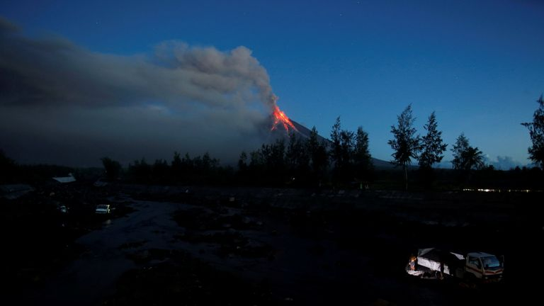 Lava cascades down the slopes of the Mayon volcano during its eruption at Daraga, Albay Province, Philippines