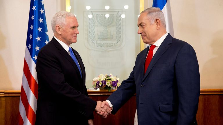 U.S. Vice President Mike Pence shakes hands with Israeli Prime Minister Benjamin Netanyahu during a meeting at the Prime Minister's office in Jerusalem
