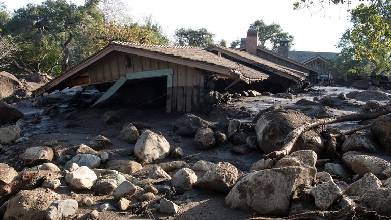 The mudslide destroyed an estimated 100 homes - sweeping some off their foundations