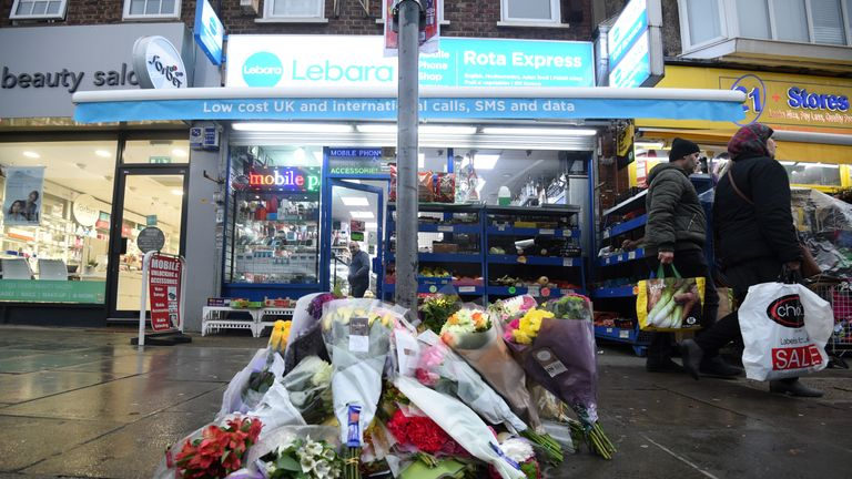 Tributes outside a shop on The Broadway in Mill Hill, north London, where a murder investigation has been launched after shop worker Vijay Patel was fatally attacked in a row over cigarette papers.