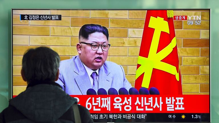 A South Korean man watches Kim Jong Un's New Year message
