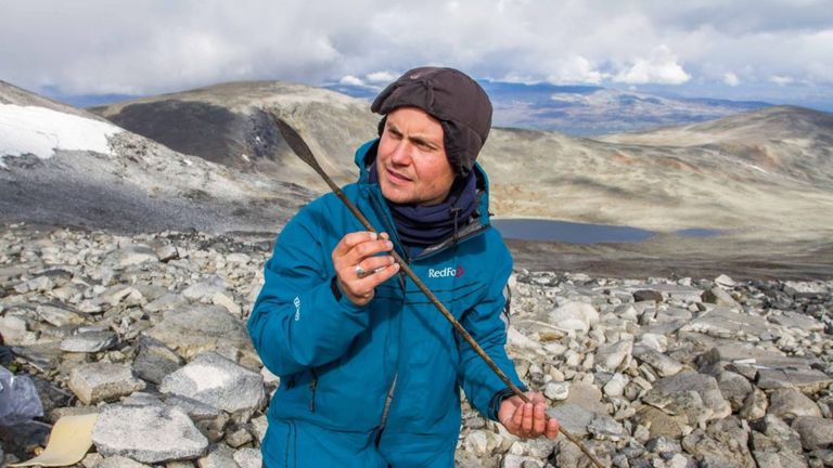 Elling Utvik Wammer holding a 1,500-year-old arrow, found during survey in Jotunheimen in 2011. Pic: Secrets of the Ice/Oppland County Council