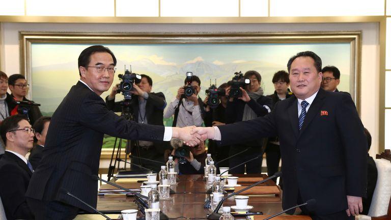 North Korean and South Korean negotiators shake hands during Tuesday's rare talks