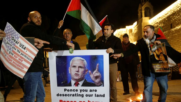 Palestinians take part in a protest against the visit of U.S. Vice President Mike Pence to Israel, in the West Bank city of Bethlehem January 21, 2018. REUTERS/Mussa Qawasma NO RESALES. NO ARCHIVES.
