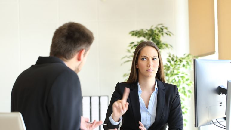 A female employee telling her male colleague something is not acceptable