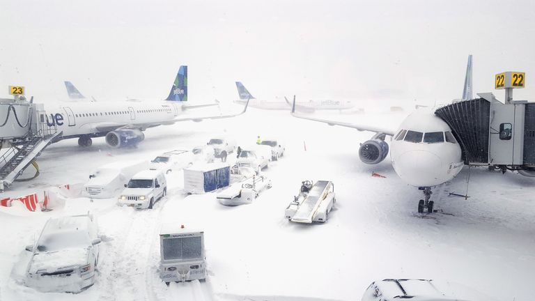 JetBlue airplanes wait at the gates outside terminal five at John F. Kennedy International Airport on January 4, 2018 in the Queens borough of New York City