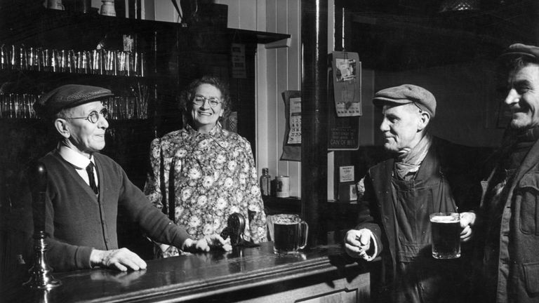 The regulars and bar staff at a public house in Windlesham, Surrey in 1957