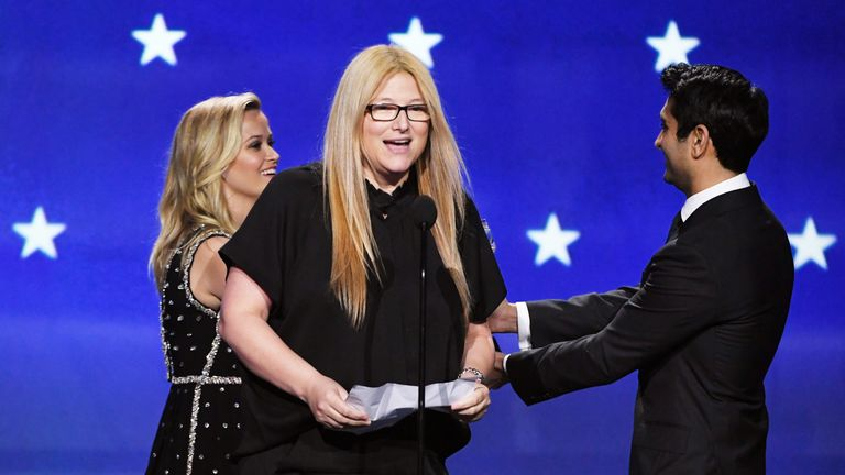Actor Reese Witherspoon and producer Bruna Papandrea accept Best Limited Series for 'Big Little Lies' from actor Kumail Nanjiani onstage during The 23rd Annual Critics' Choice Awards at Barker Hangar on January 11, 2018 in Santa Monica, California. (Photo by Kevin Winter/Getty Images)