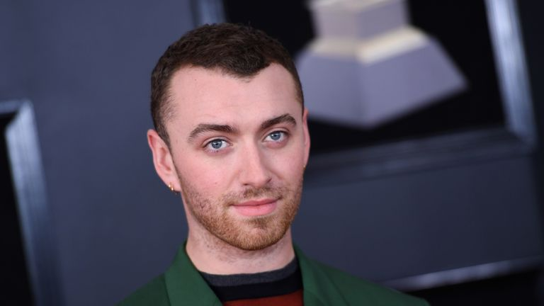 Sam Smith with a white rose in his lapel