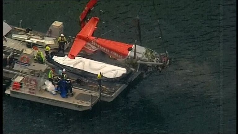 The plane wreckage is lifted from the water