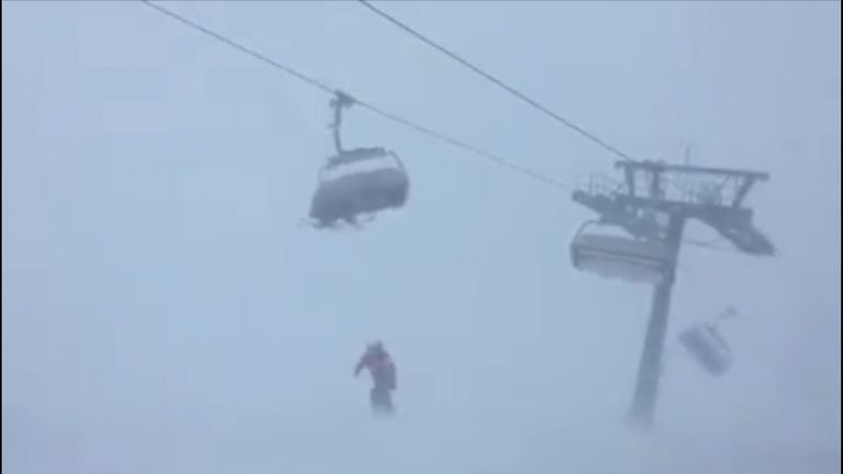 Ski resort staff are unable to help the stranded skiers