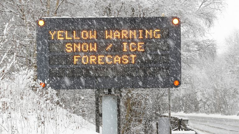 Heavy snow falling on the A9 motorway near Killiecrankie, in Scotland