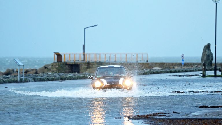 A car drives through a flooded car park in Salthill, Galway, as Storm Eleanor lashed the UK and Ireland with violent storm-force winds of up to 100mph, leaving thousands of homes without power and hitting transport links. PRESS ASSOCIATION Photo. Picture date: Wednesday January 3, 2018. Widespread disruption is expected on Wednesday after the storm swept across the country overnight carrying heavy rain, hail and dramatic thunder and lightning. See PA story WEATHER Gales Ireland. Photo credit should read: Brian Lawless/PA Wire