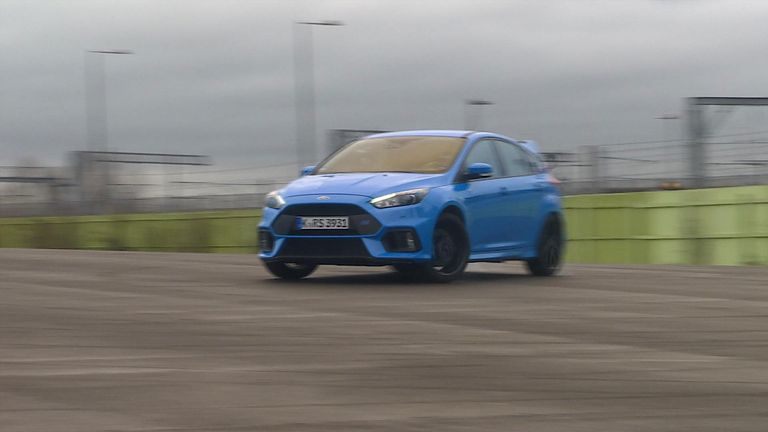 Ford fiesta driving in car park.
