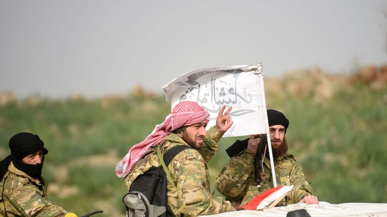 Syrian opposition fighters accompany the Turkish army near the Syria border at Hassa