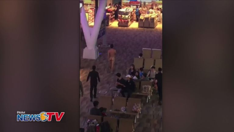 Other travellers watched as the man wandered around without a stitch on. Pic: Phuket News TV