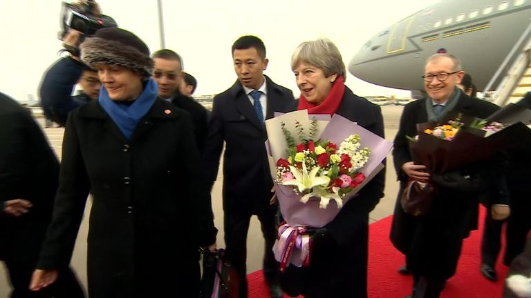 Theresa May arrives in China for trade talks