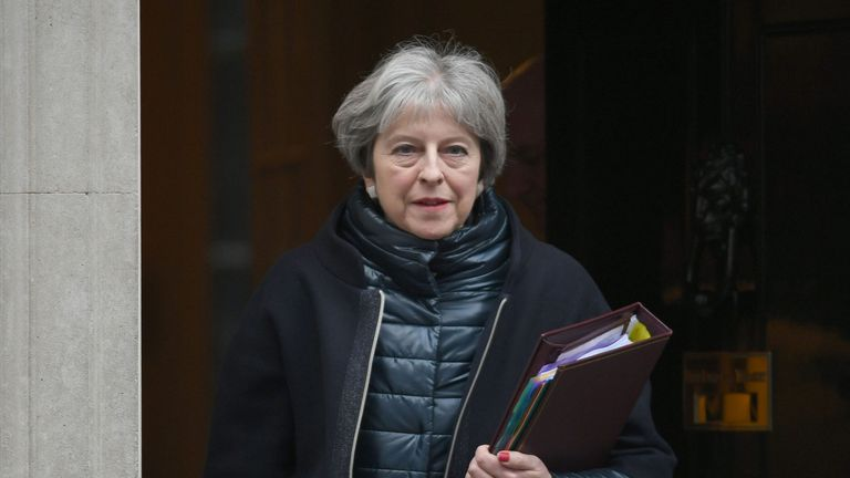 Theresa May leaving Downing Street ahead of Prime Minister's Questions