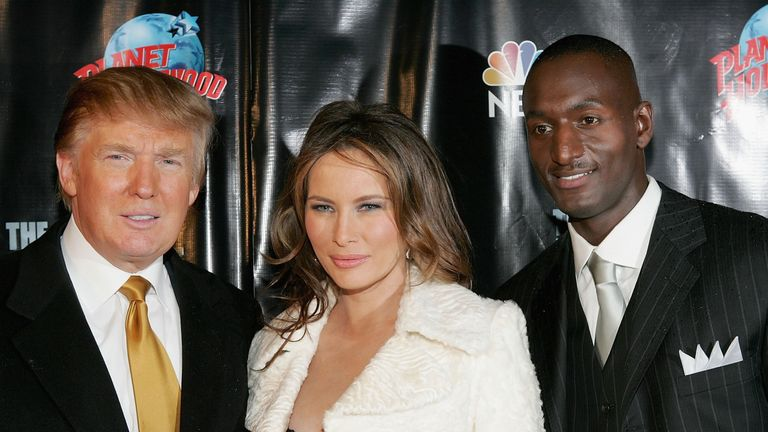 "Donald and Melania Trump pose with Randal Pinkett, the winner of ""The Apprentice"" in the 2005 season"
