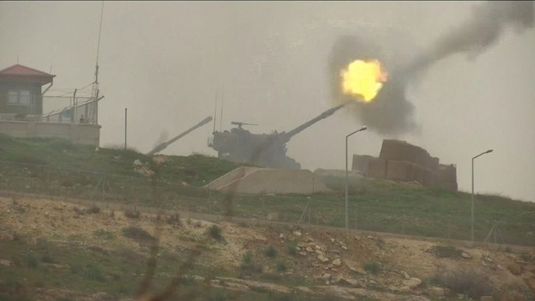 A Turkish tank opens fire on a Kurdish target in Syria