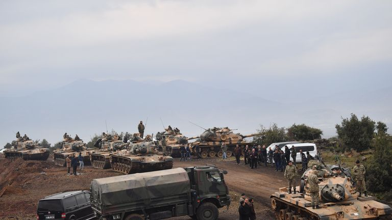 Turkish tanks and soldiers gather near the Syrian border