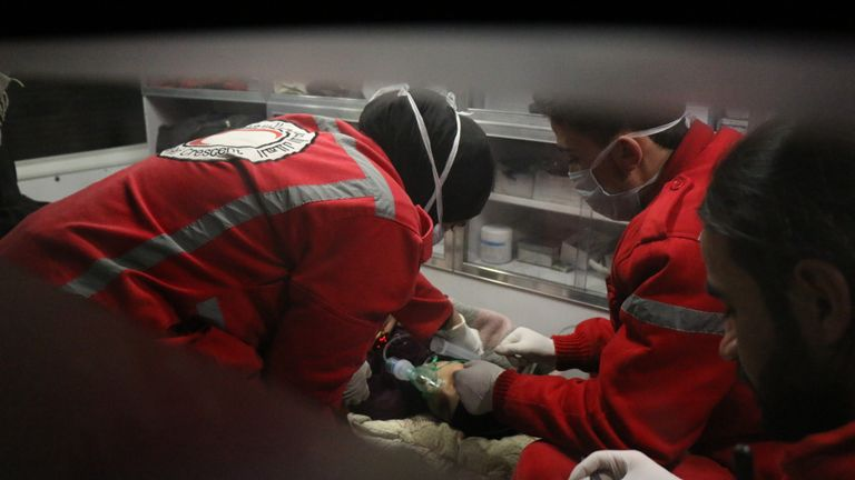 Doctors from the Red Crescent treat an injured child at a field hospital in Ghouta. Pic: UOSSM