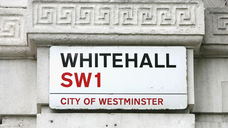LONDON-SEPTEMBER 17:  LONDON-SEPTEMBER 17:  The street sign for Whitehall sits on a building across from Britain's Houses of Parliament on September 17, 2004 in London, England.(Photo by Scott Barbour/Getty Images)