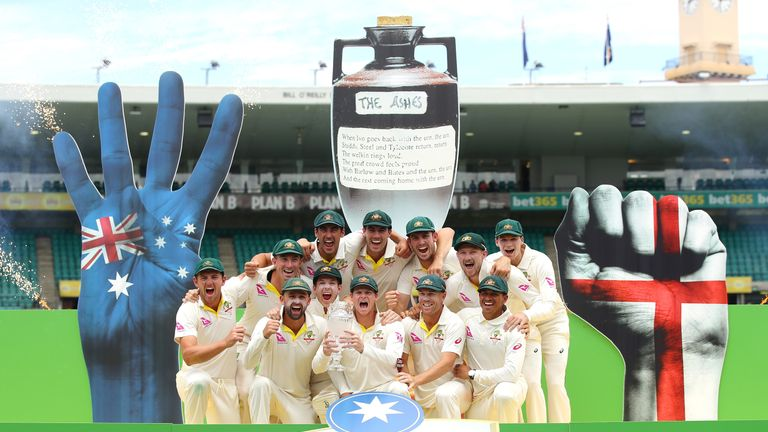 SYDNEY, AUSTRALIA - JANUARY 08:  The Australian team celebrate winning the Ashes series with the trophy during day five of the Fifth Test match in the 2017