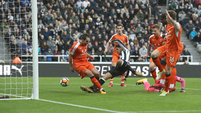 Ayoze Perez of Newcastle United scores the opening goal during The Emirates FA Cup Third Round match v Luton Town