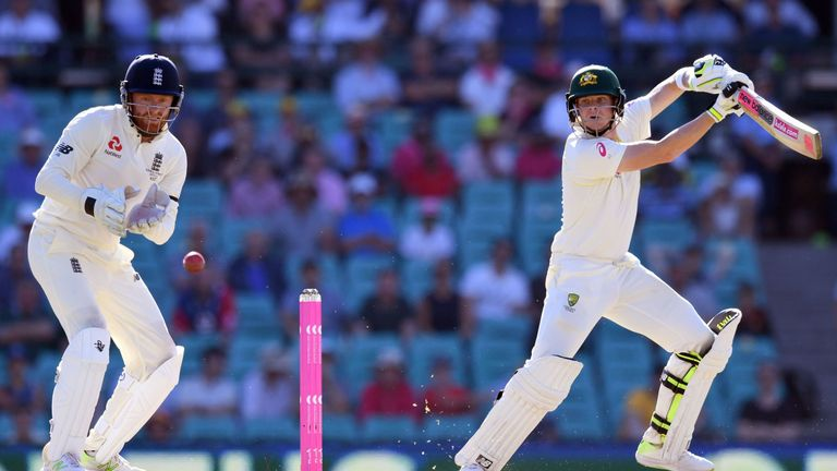 Australia's batsman Steve Smith (R) cuts the ball past England's wicketkeeper Jonny Bairstow on the second day of the fifth Ashes cricket Test match at the