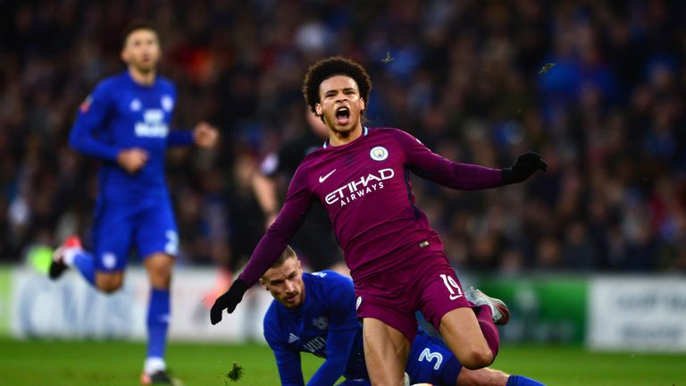 CARDIFF, WALES - JANUARY 28:  Leroy Sane of Manchester City is tackled by Joe Bennett of Cardiff City during The Emirates FA Cup Fourth Round between Cardi