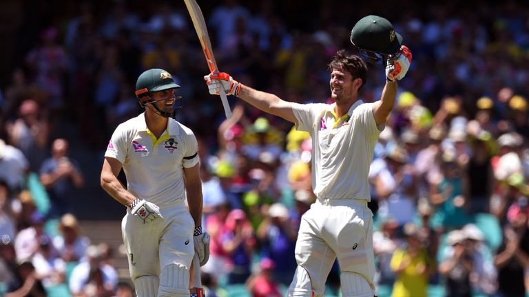 Australia's Mitchell Marsh (R) celebrates scoring his century against England with his teammate and brother Shaun Marsh (L) on the fourth day of the fifth