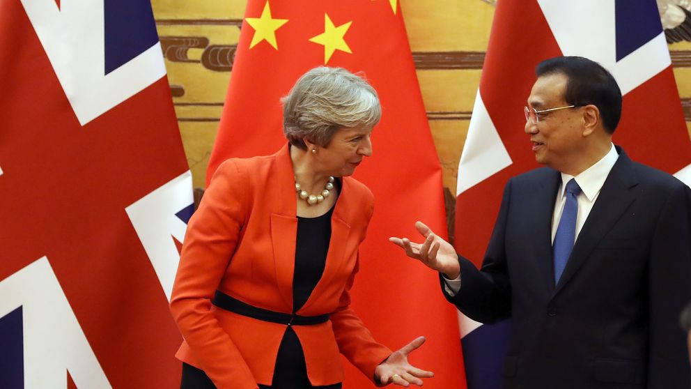 Theresa May and Chinese Premier Li Keqiang speak during a signing ceremony in the 'Great Hall of the People' on January 31, 2018 in Beijing, China