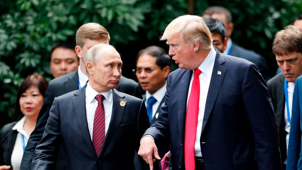 Brushing Russia probe aside, Trump, Putin lay groundwork for future talks