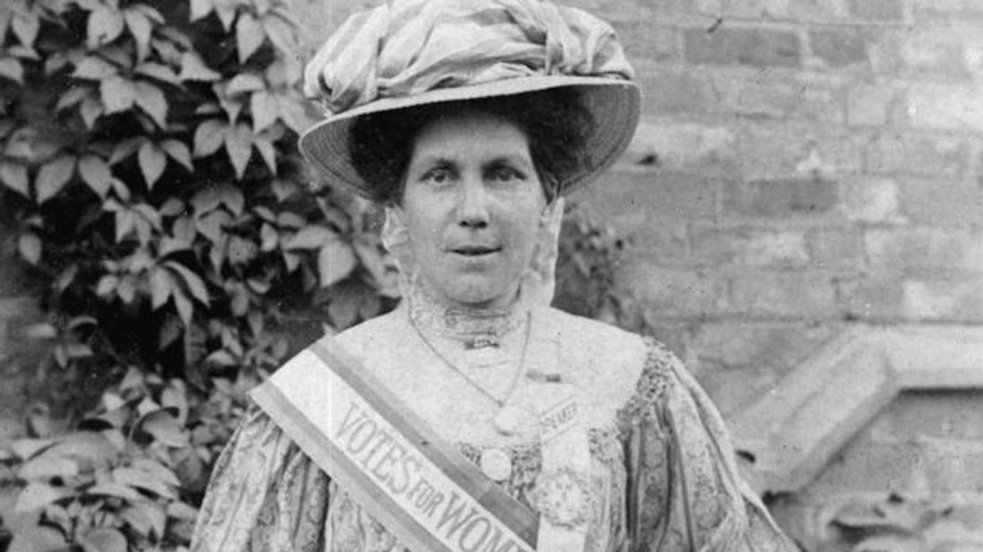 A sister of freedom, Alice Hawkins in her 'votes for women' sash sporting the suffragette colours green, purple and white. Pic: Peter Barratt