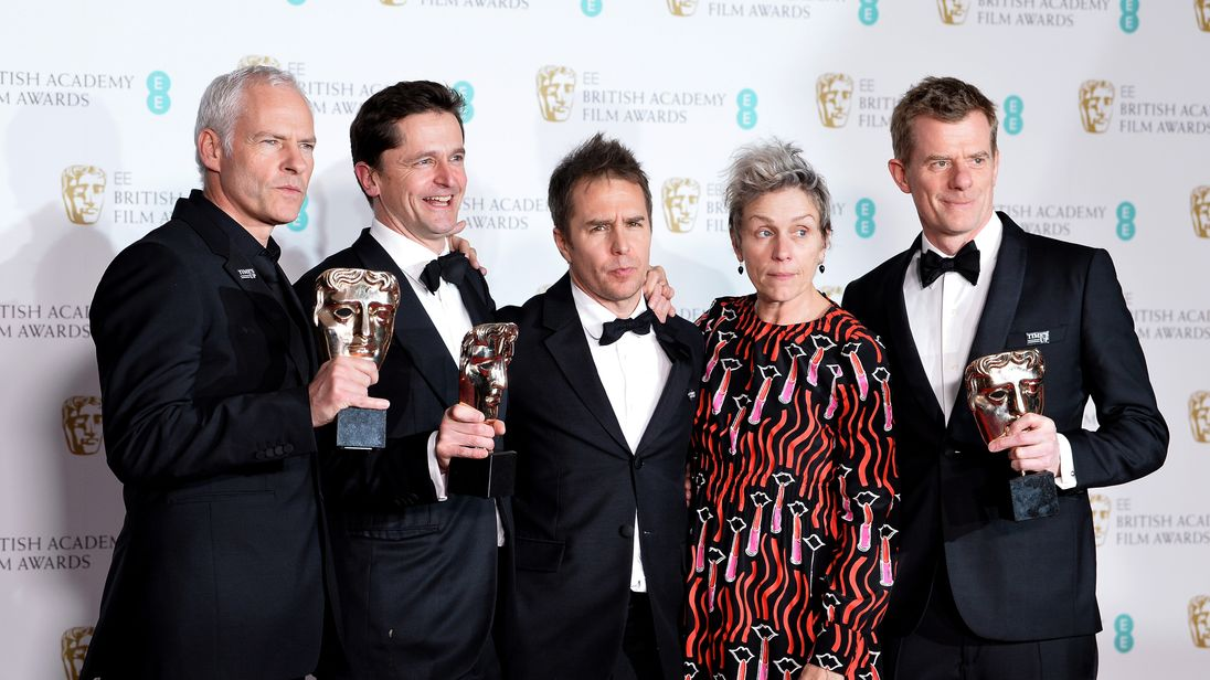 LONDON, ENGLAND - FEBRUARY 18: Martin McDonagh (L), Pete Czernin (2ndL) and Graham Broadbent (R), winners of the Outstanding British Film award, Sam Rockwell, winnerof the Best Supporting Actor award and Frances McDormand, winner of the Best Actress award pose in the press room during the EE British Academy Film Awards (BAFTA) held at Royal Albert Hall on February 18, 2018 in London, England. (Photo by Jeff Spicer/Jeff Spicer/Getty Images)