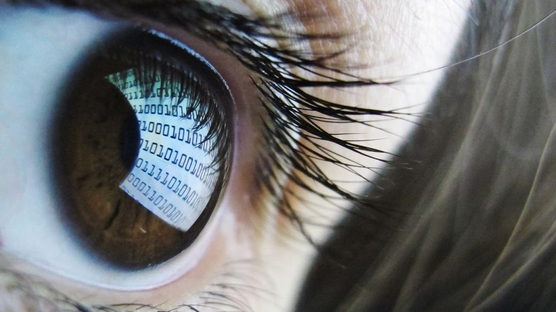 A pictures shows binary code reflected from a computer screen in a woman's eye on October 22, 2012. AFP PHOTO / LEON NEAL (Photo credit should read LEON NEAL/AFP/Getty Images)