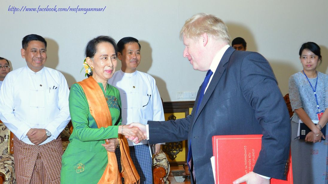 Boris Johnson shakes hands with Aung San Suu Kyi