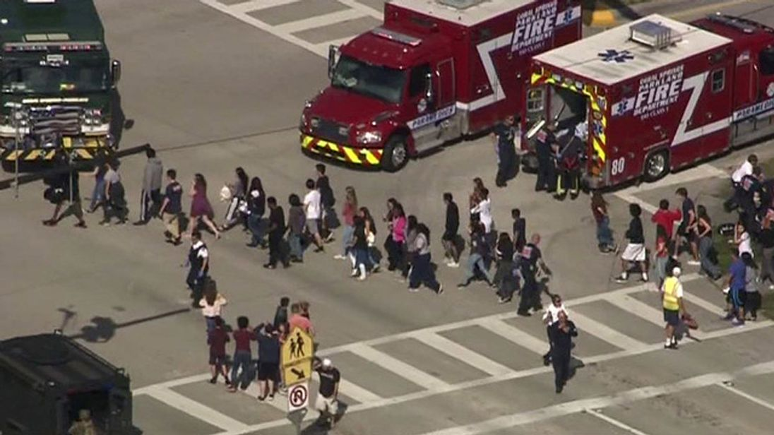 RTX4WX8814 Feb. 2018PARKLAND, UNITED STATESStudents are evacuated from Marjory Stoneman Douglas High School during a shooting incident in Parkland, Florida, U.S. February 14, 2018 in a still image from video. WSVN.com