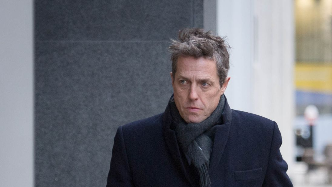 Hugh Grant arrives at the Rolls Building in London after he settled his phone hacking claims against Mirror Group Newspapers