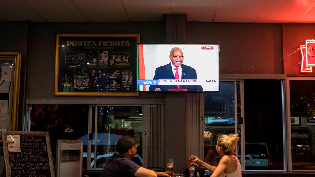 People watch Jacob Zuma address the nation as he leaves power