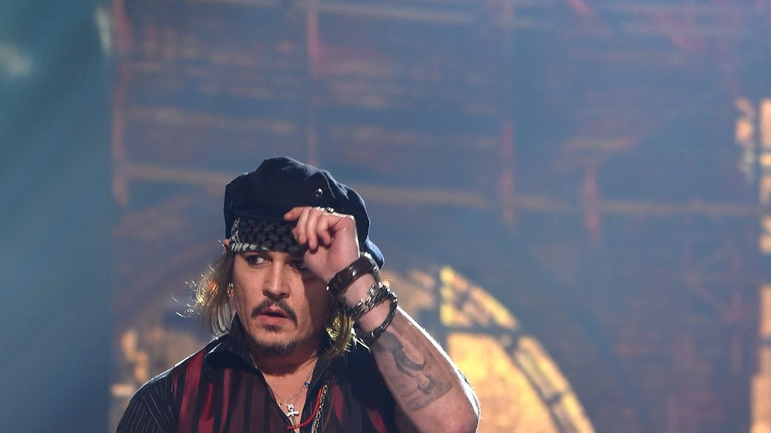 Johnny Depp settles multimillion-dollar lawsuit against former managers