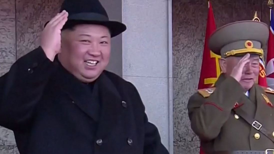 Kim Jong Un watches a military parade in Pyongyang